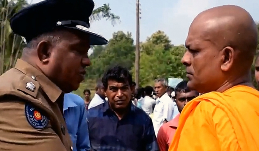 Buddhist monk threatens Tamil officer (video)