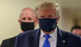 Trump finally wears a mask