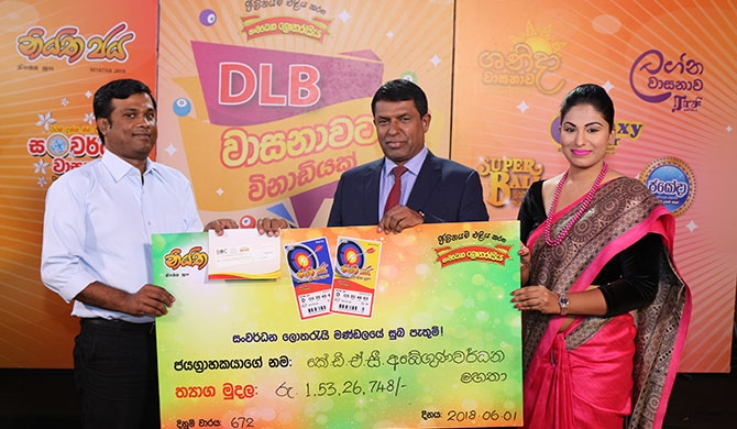 DLB hands over prizes to lottery winners