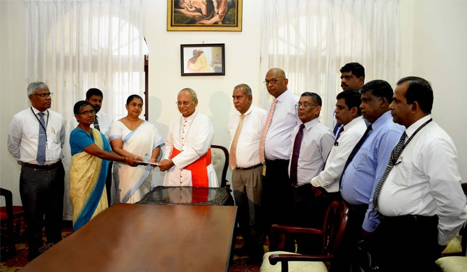 NSB donates Vesak Bhakthi Gee fund for bomb victims