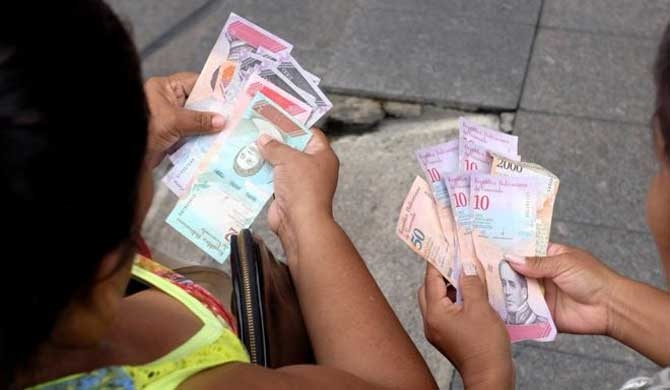Venezuela paralysed by new currency