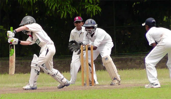 School cricket officials in double game