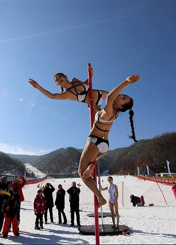 Pole dancing in the snow! (Pics)