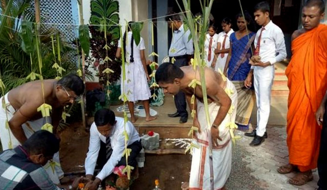 Buddhist monks, Hindu priest cook Pongal milk rice