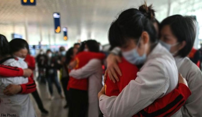 China reports 17 more cases amid new infections in Wuhan