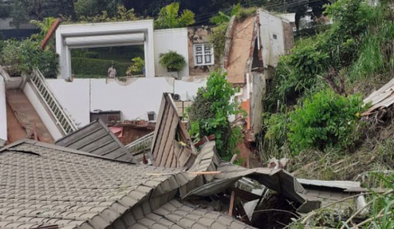 5-storey building collapses onto house