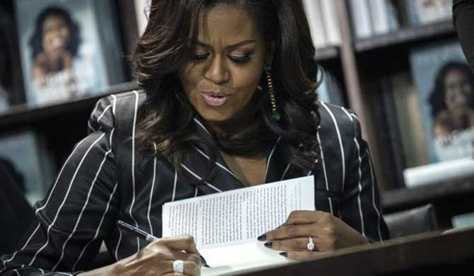 Michelle Obama's memoir breaks sales record in 15 days