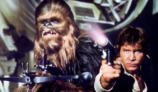 Peter Mayhew plays Chewbacca (L) alongside Harrison Ford in Star Wars Episode IV