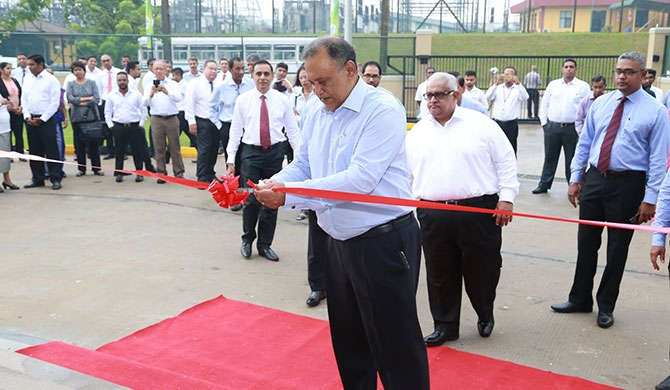 Susantha Ratnayake, Chairman of John Keells Group, cuts ribbon to ceremonially open facility.