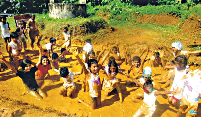 Principal allows students to wallow in mud