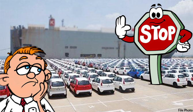 122 vehicles arrive at H'tota despite ban ; jobs at risk!