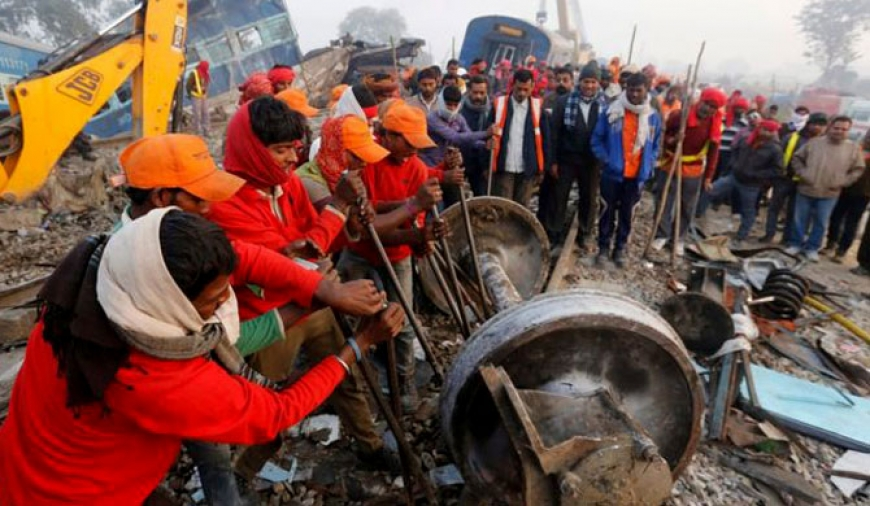 Rescuers combing Indian train wreckage