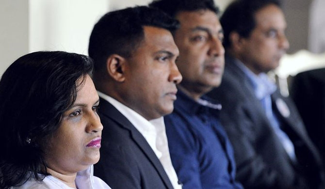 Luxmy Viyapuri, left, and other members of the Transnational Government of Tamil Eelam (TGTE) focus on speakers during their meeting in Scarborough on May 12. The TGTE continues to work for an independent Tamil state in Sri Lanka 10 years after a civil war there ended in defeat for the separatist Tamil Tigers. - Torstar staff photo