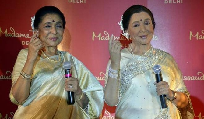 ONE OF A KIND Asha Bhosle with her wax figure unveiled at Madame Tussauds in New Delhi   | Photo Credit: V. Sudershan