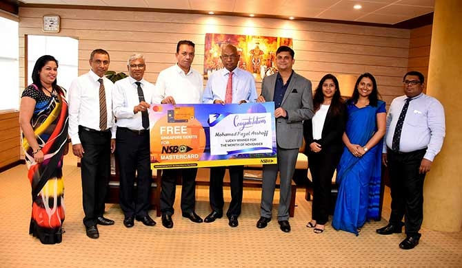 From left – Ms. Dulakshi Perera, Senior Manager – Marketing, NSB; Mr. Kamal Wijeyawardena, Chief Manager - Card Centre, NSB; Mr. Lal Karunatilake, Deputy General Manager – Marketing, NSB; Mr. M. F. Arshoff, the winner of the two return air tickets to Singapore; Mr. S. D. N. Perera, General Manager / Chief Executive Officer, NSB; Mr. R. B. Santosh Kumar, Country Manager - Sri Lanka & Maldives, Mastercard; Ms. Sheranga Perera - Senior Specialist, Mastercard; Ms. Upekha Gunasekera, Manager - Digital Media, NSB and Mr. Chandana Dissanayake, Chief Manager, NSB