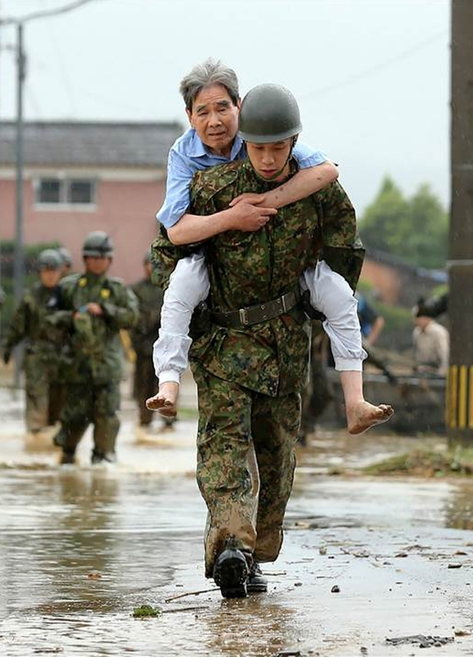 Floods in Japan kill 6; search for 20 missing slowed by mud