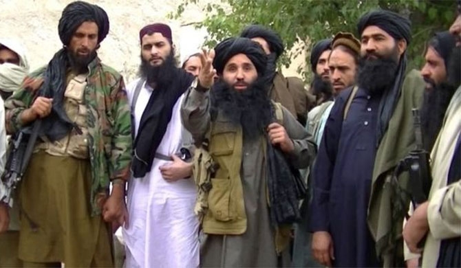 Mullah Fazlullah (middle) in a video issued by the Pakistan Taliban