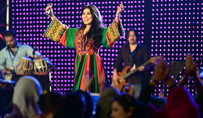 "Afghan female singer Aryana Sayeed performs during a ""Peace Concert"" in Babur Garden in Kabul on October 19, 2013. (MASSOUD HOSSAINI/Agence France-Presse/Getty Images)"