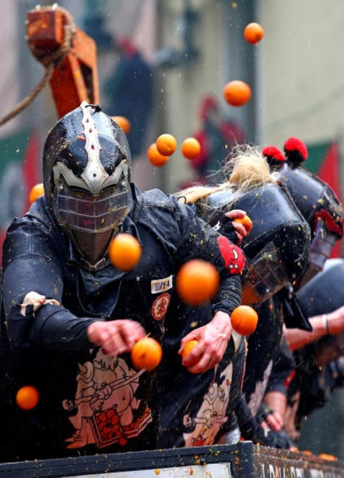 Members of rival teams fight with oranges during an annual carnival battle in the northern Italian town of Ivrea, Italy on Feb 11, 2018.