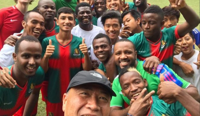 Smile! The footballers of All Black FC - which has expanded to welcome Chinese Hongkongers and other ethnic minorities