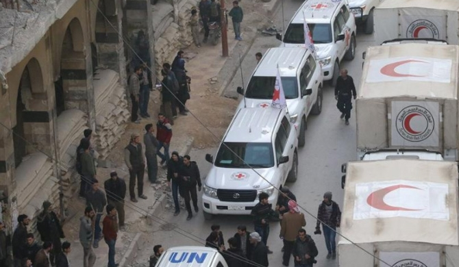 Syria aid convoy retreats amid shelling